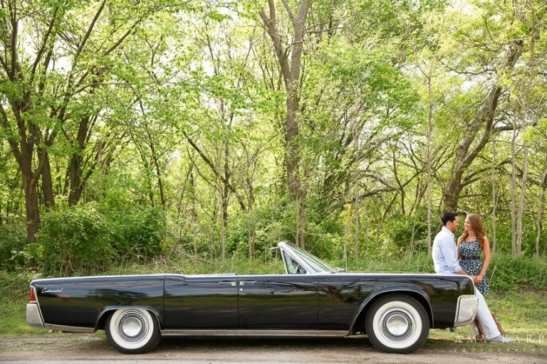 Outdoor engagement photo on classic car - Photo by Amy Karp Photography