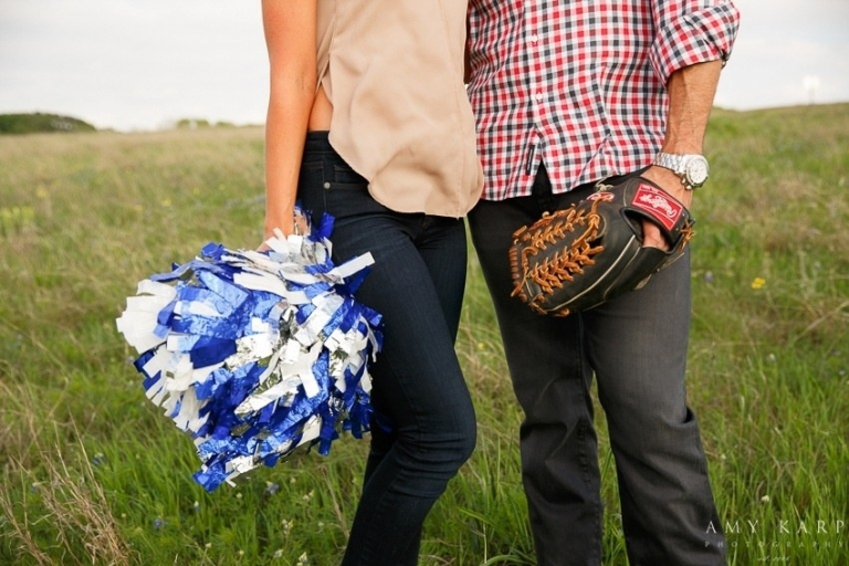 Engagement photo in field with pompom and baseball glove - Photo by Amy Karp Photography
