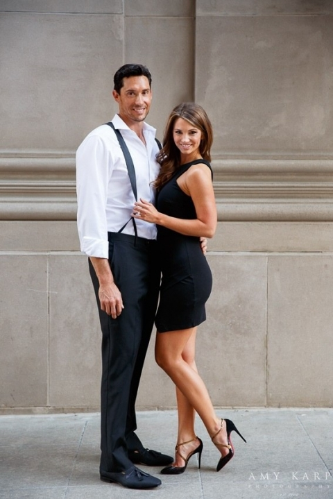 Engagement photo outside by building - Photo by Amy Karp Photography