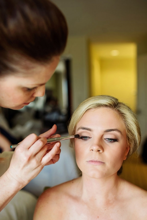 Bride having makeup done - Photo by Celina Gomez Photography