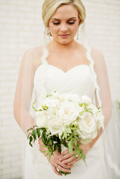Bride with lace trimmed veil - Photo by Celina Gomez Photography