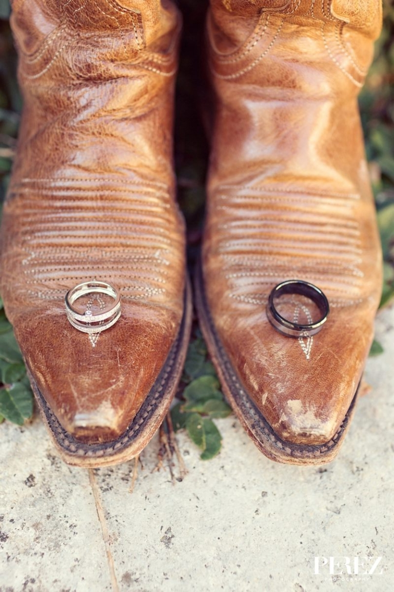 Wedding rings on cowboy boots - Photo by Perez Photography