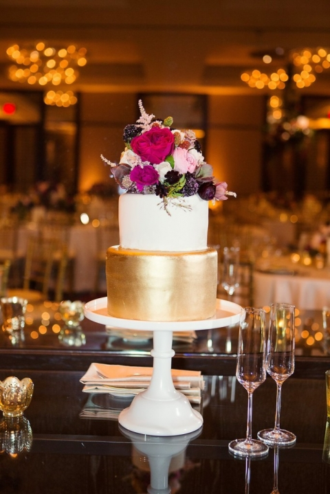 Bold gold cake with floral topper - Photo by Joshua Aull Photography
