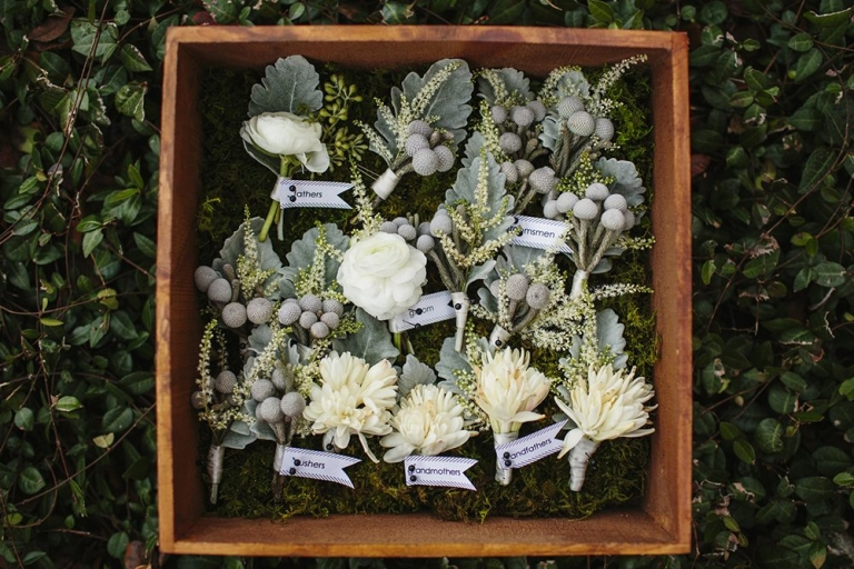 Winter boutonnieres in wooden box - Photo by Sara & Rocky Photography