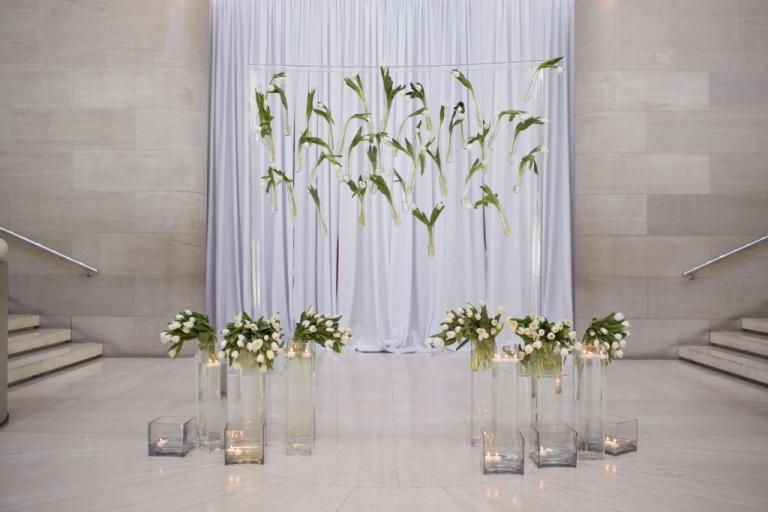 Modern ceremony setup with white tulips - Photo by Jenny Martell Photography