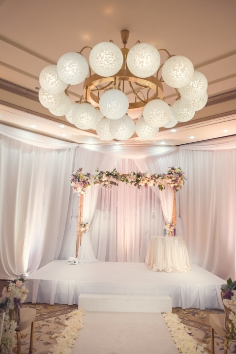 Elegant Four Seasons ceremony with white draping - Photo by TRU Identity Photography + Designs