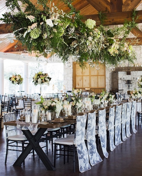 Outdoor wedding reception with hanging floral centerpiece over head table - Photo by Helmut Walker - Floral by Branching Out Events