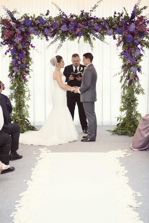 Purple and pink wedding ceremony floral arch - Photo by Sarah Kate Photography - Floral by Branching Out Events