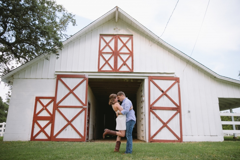 Outdoor engagement photo outside barn - Photo by Evan Godwin Photography