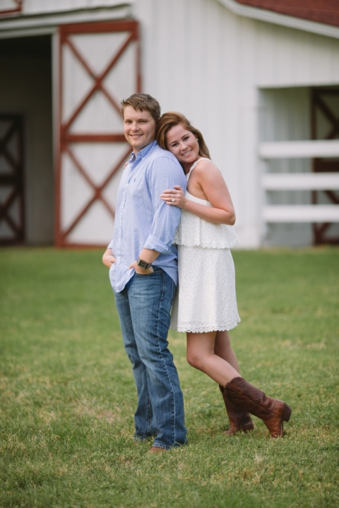 Outdoor engagement photo with white barn - Photo by Evan Godwin Photography