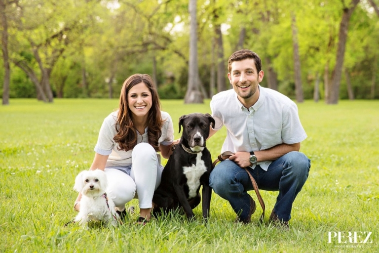 Outdoor engagement picture with dogs - Photo by Perez Photography