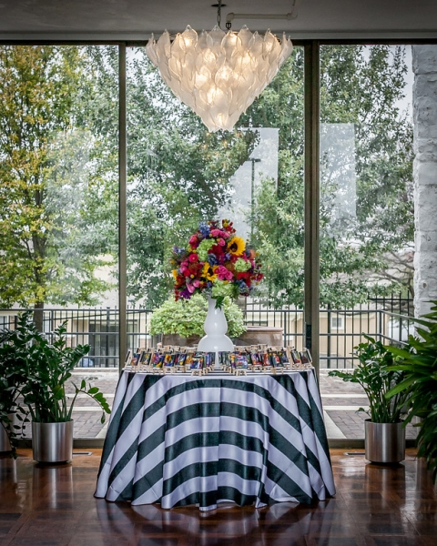 Escort card table with striped linen - Photo by Daniel Brennan