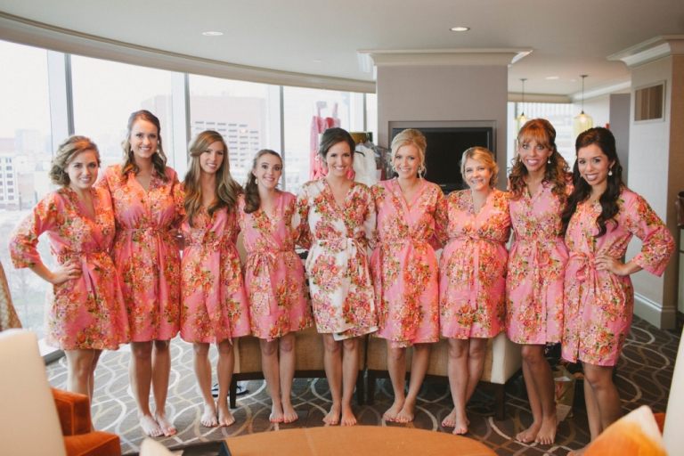 Bride and bridesmaids in matching getting ready floral robes - Photo by Laura Elizabeth Photographers