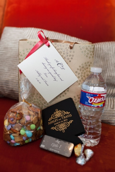 Custom out-of-town guest gift bags with trail mix, water, personal note, and custom koozie - Photo by Laura Elizabeth Photographers