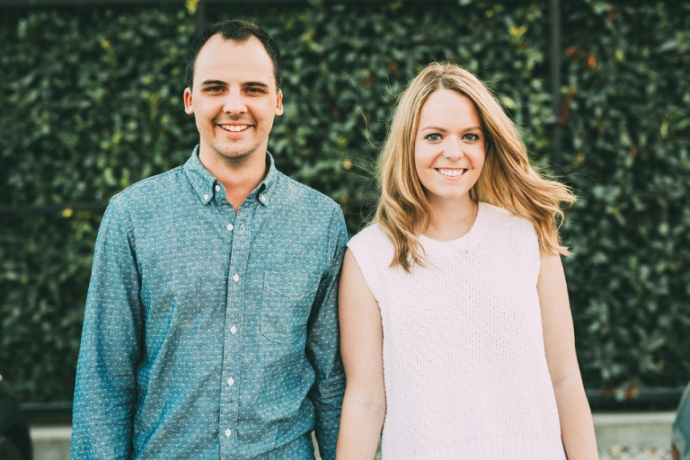 Engagement pictures taken outside in front of vine covered wall - Photo by Grant Daniels Photography