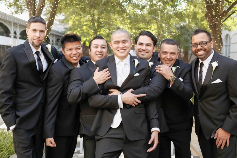 Groom and groomsmen in tuxedos with calla lily boutonniere and pocket square - Photo by Fairy Tale Photography