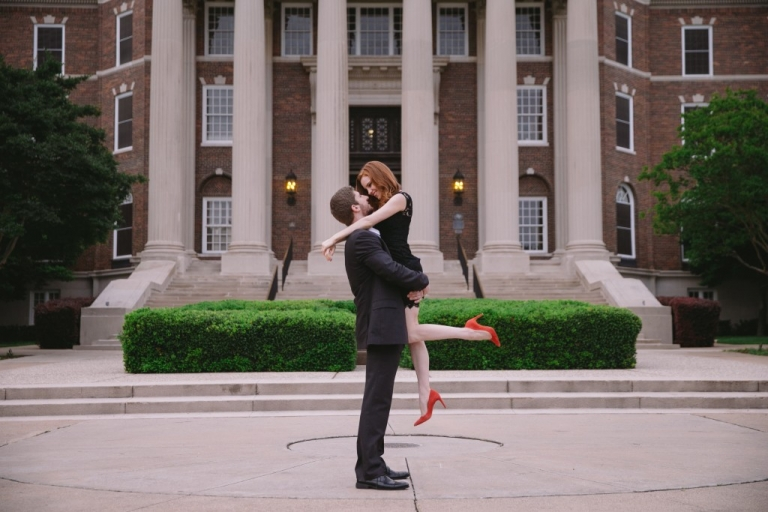 Outdoor engagement photos in front of building at SMU in Dallas, TX - Photo by Evan Godwin Photography