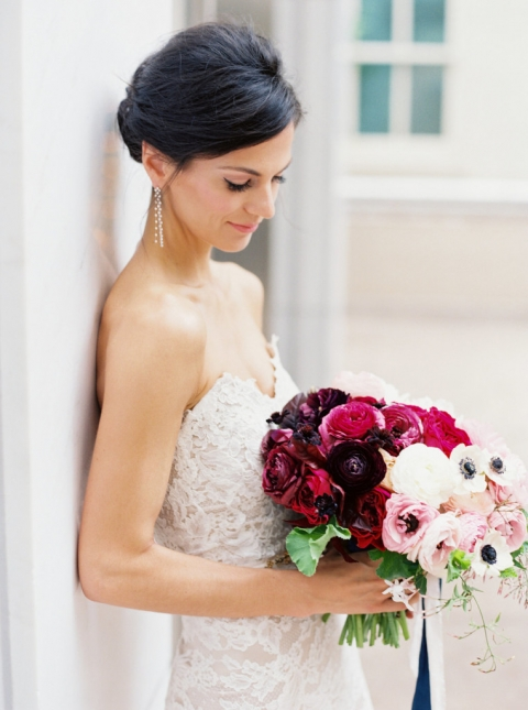 Bride in vintage white lace strapless dress with dangling earrings and beautiful white and deep pink and purple wedding brides bouquet - Photo by Joshua Aull Photography