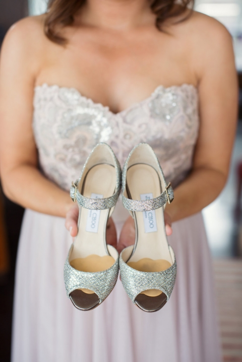 Jimmy Choo sparkly wedding shoes being held by bridesmaid - Photo by Joshua Aull Photography