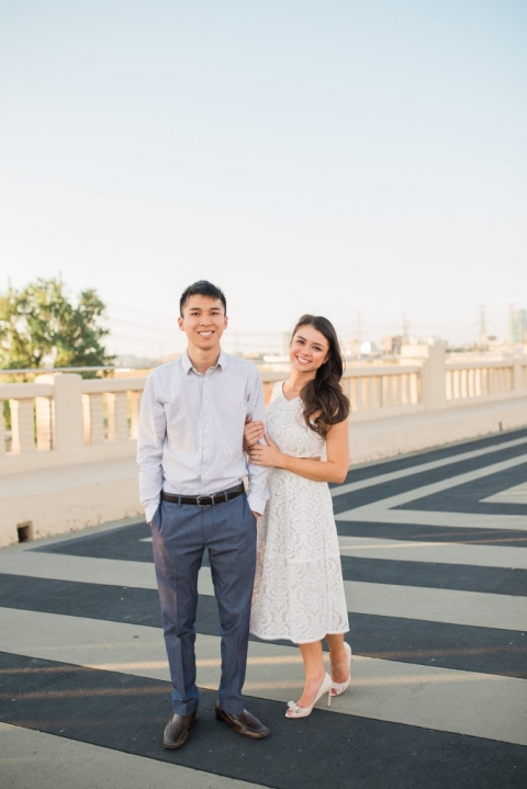 Couple posing on bridge in Dallas outdoor engagement photos - Photo by Texas Sweet Photography