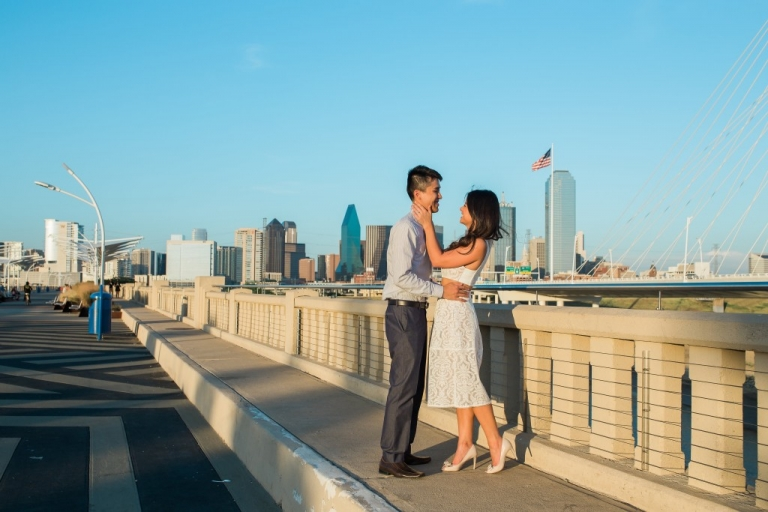 Outdoor engagement pictures on bride with Dallas skyline in background - Photo by Texas Sweet Photography