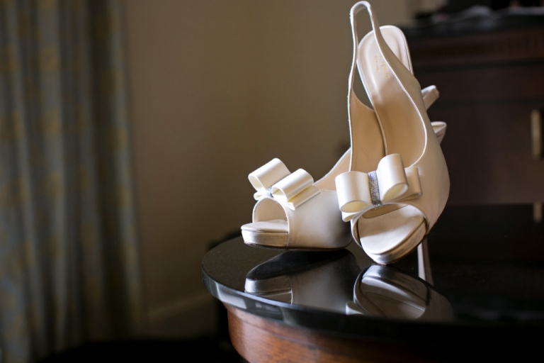 White Kate Spade bridal shoes with bow and sequin detail - Photo by Jenny & Eddie
