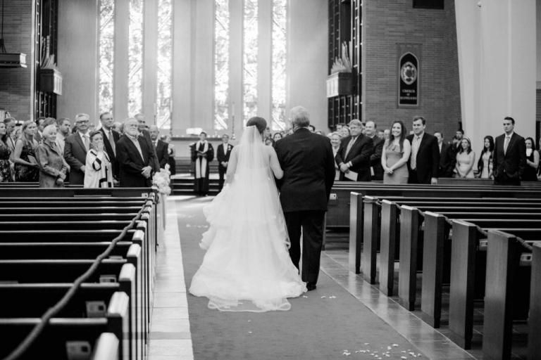 Bride escorted down aisle by her father at summer wedding ceremony at First Presbyterian Church in Downtown Fort Worth, TX - Photo by Arden Prucha Photography