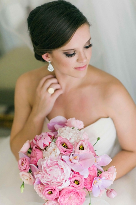 Stunning photo of bride posing with pink summer bridal bouquet before wedding in Fort Worth, TX - Photo by Arden Prucha Photography