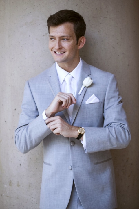 Groom in grey tux with white pocket square and single white tulip boutonniere - Photos by Jenny & Eddie