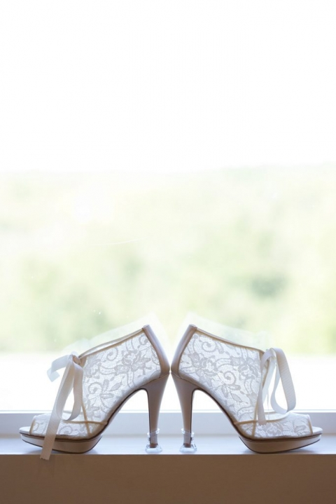 Brides white lace wedding booties for fall wedding at The Milestone - Photos by The Mamones