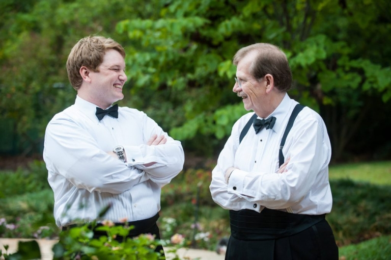 Groom and father sharing a laugh before October fall wedding in Dallas, Texas - Photos by Gary Donihoo