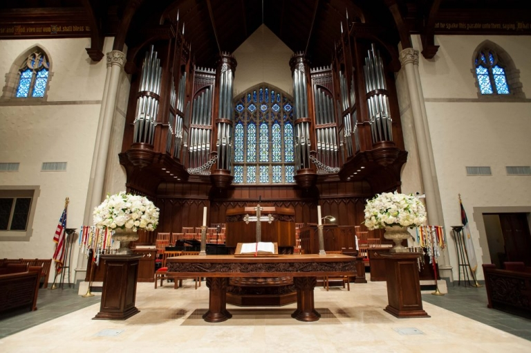 Fall wedding ceremony at Highland Park United Methodist Church with white floral arrangements in Sanctuary - Photos by Gary Donihoo