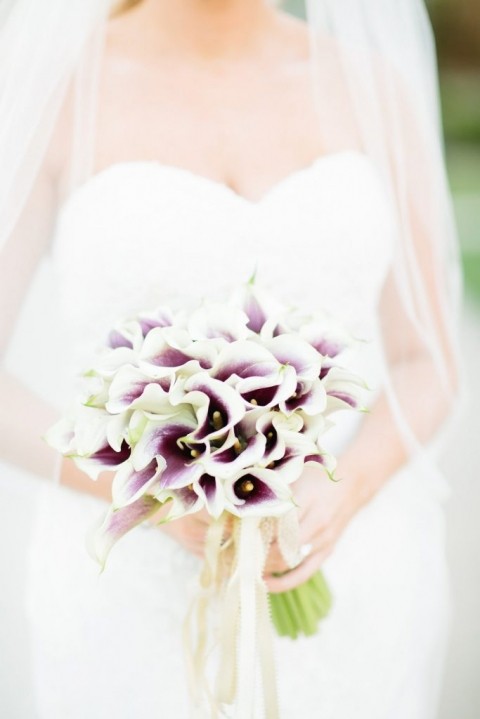 Fall brides bouquet with white and deep purple colored flowers - Photos by The Tarnos