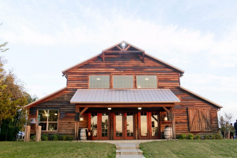 Wooden barn at Thistle Springs Ranch for fall wedding in Cleburne, Texas - Photos by Mary Fields Photography