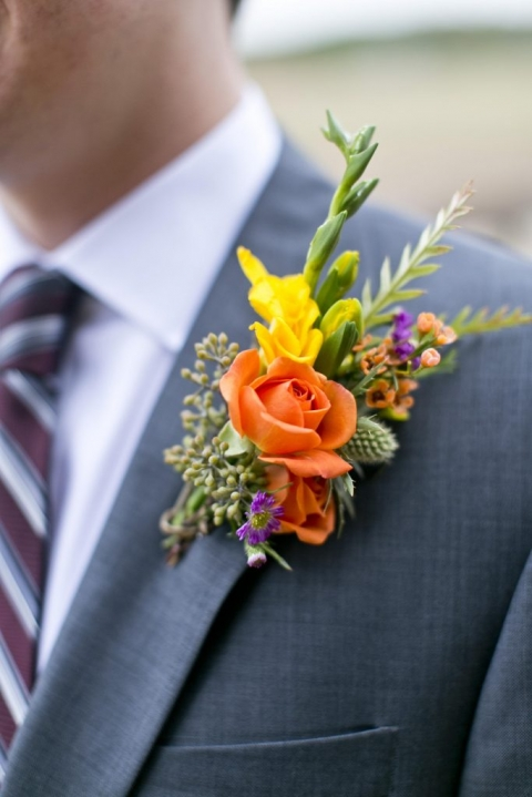Colorful groom and groomsmen boutonnieres for fall wedding at Thistle Springs Ranch in Cleburne, Texas - Photos by Mary Fields Photography