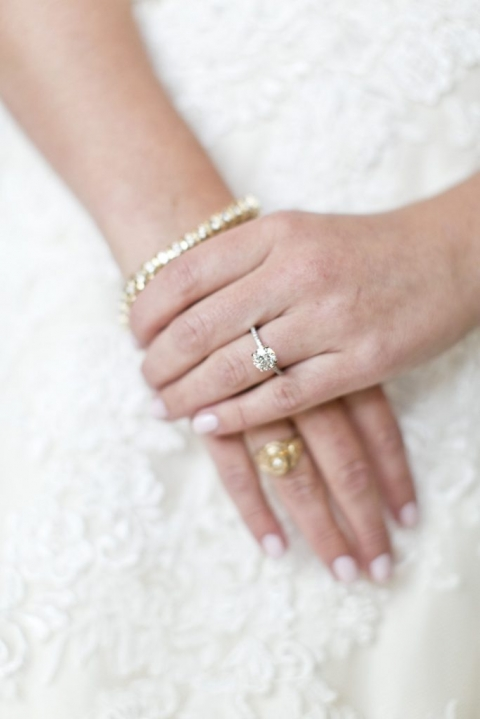 Bride in white dress with diamond bracelet engagement rind and gold college ring for fall wedding at Thistle Springs Ranch in Cleburne, Texas - Photos by Mary Fields Photography
