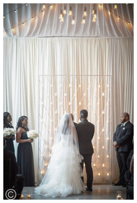 Winter ceremony area at Hotel Zaza in Dallas, Texas white draping with floating candles November winter wedding - Photos by Relive Photography by Laura Parent