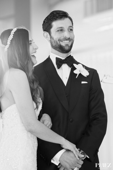 Bride and groom during formal winter Jewish wedding ceremony at The Joule Hotel in Dallas, Texas - Photos by Perez Photography