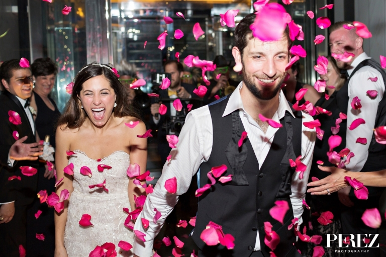 Bride and groom pink flower petal exit from winter wedding at The Joule Hotel in Dallas, Texas - Photos by Perez Photography