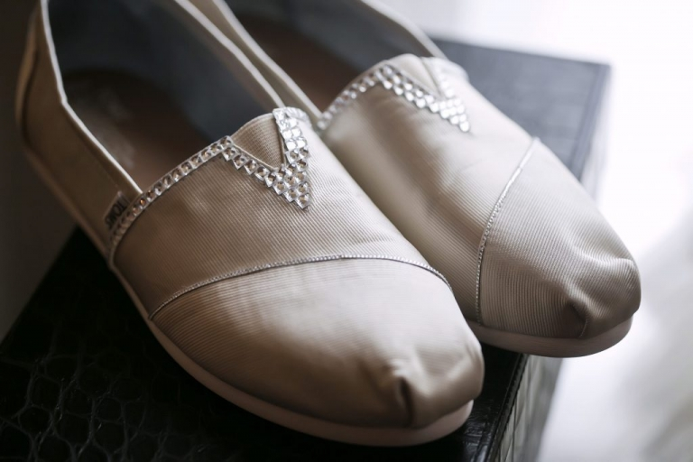 Bride custom white satin Toms wedding shoes with crystal embellishments before summer wedding renewal ceremony in Dallas, Texas - Photos by Jenny & Eddie