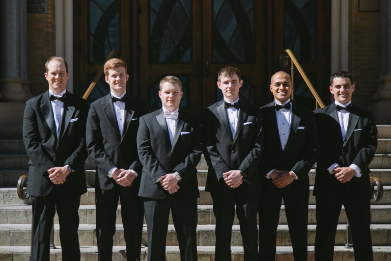 Groom and groomsmen outside of Cathedral Shrine of the Virgin of Guadalupe before winter wedding in Dallas, Texas - Photo by Evan Godwin Photography