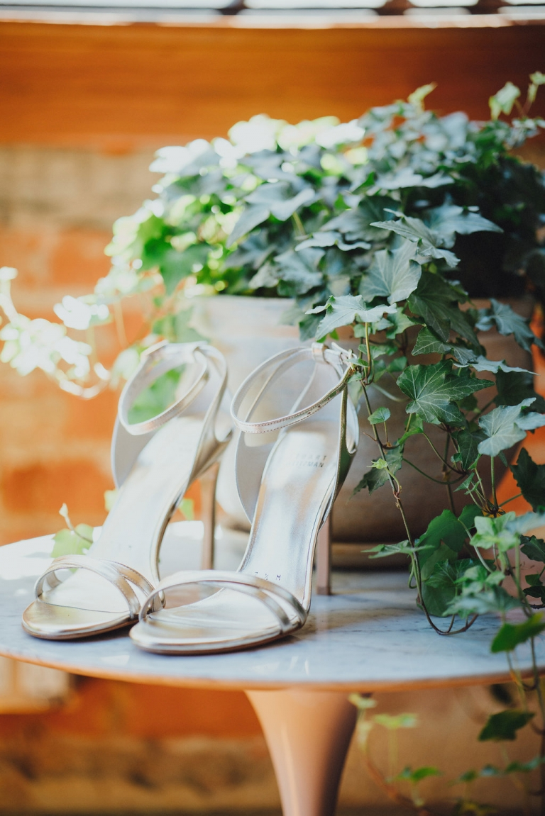 Brides silver strappy Stewart Weitzman wedding day heels - Photos by Grant Daniels Photography