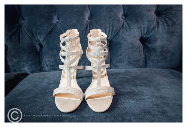 Brides sparkly wedding shoes on blue sofa before spring wedding in Dallas, Texas - Photo by Relive Photography by Laura Parent