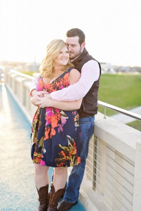 Dallas outdoor engagement photos couple standing on bridge - Photos by Adrian Faubel photography
