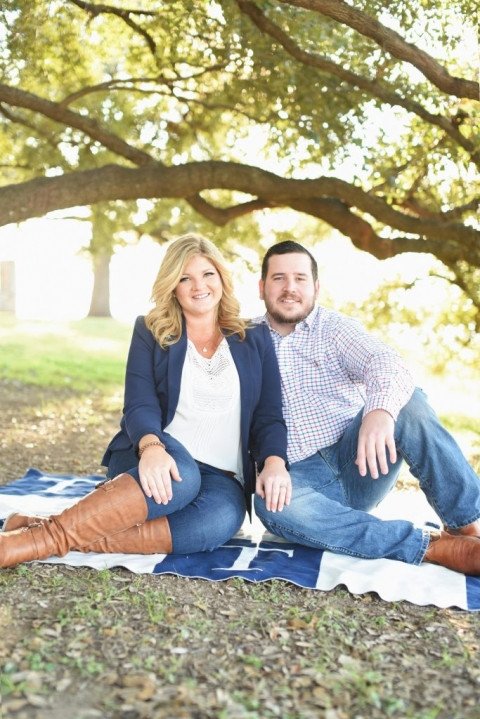 Outdoor engagement photos couple sitting on custom monogrammed blanket and sitting under tree in Dallas - Photos by Adrian Faubel photography