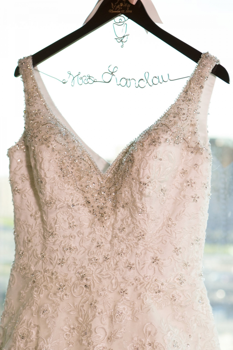 Brides wedding dress hanging on a custom hanger before fall jewish wedding in Dallas, Texas - Photos by The Mamones
