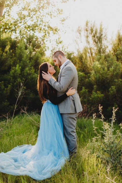 Outdoor engagement photos in field brie wearing tulle skirt - Photo by Two Pair Photography